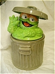 This jar is really unique.  It isn't like the older one, this one has Oscar popping his head out of the garbage can.  Lovable Oscar is handsomely portrayed waving from his famous trash can in this fun...