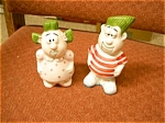 Click here to enlarge image and see more about item people: Man and Woman Funny Salt & Pepper shakers