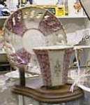 Click here to enlarge image and see more about item pinkcup: Tall pink and white with legs cup and saucer