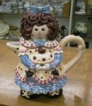Click here to enlarge image and see more about item raggedyann: Raggedy Ann look alike Teapot