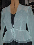Click here to enlarge image and see more about item blb403: Vintage sheer tie front blue blouse