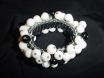 Click here to enlarge image and see more about item brb008: Black & white plastic beaded elastic bracelet