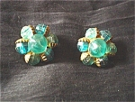 Click here to enlarge image and see more about item cel005: Green Plastic Cluster Clip Earrings