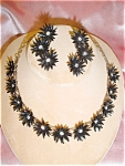 Click to view larger image of Black Plastic Flower Necklace and Earring Set (Image1)