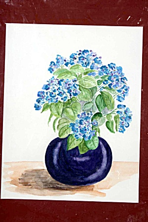 Blue Hydrangeas In Round Vase