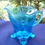 Click here to enlarge image and see more about item 197D: Swag with Brackets Blue Creamer