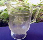 Shell and Tassel Water Pitcher