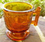 Click here to enlarge image and see more about item 5864: Atterbury Robin Amber Glass Mug