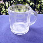 Click here to enlarge image and see more about item 6477: Higbee Toy Glass Drum Mug