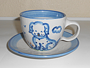M A Hadley Pottery Puppy Decorated Cup & Saucer Set