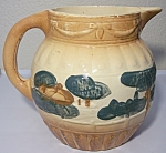 Click here to enlarge image and see more about item 14951: ROSEVILLE POTTERY EARLY DECORATED PITCHER!
