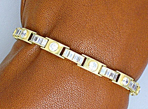Bracelet. 14 K Gold Bagette and round CZ Tennis  (Image1)