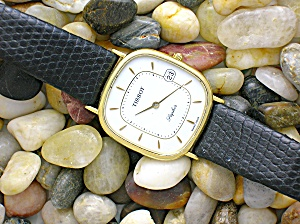 TISSOT 14K gold men's dress wrist watch . . . (Image1)