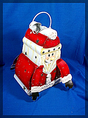 Santa Luminary, Metal with glitter. Holds a tea light (Image1)