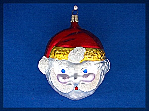 Santa face Christmas tree ornament with red cap . . (Image1)