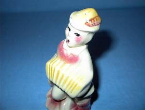 Vintage SHAWNEE Pottery  Salt ShakerBoy With Accordian. (Image1)
