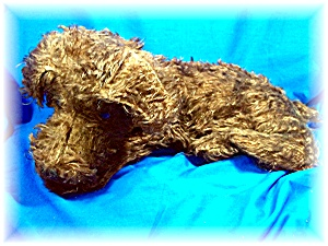 Vintage Brown Mohair Straw Stuffed Dog Pajama Holder.