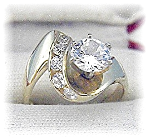 Ring 14 K Gold 1 1/4 round Channel Set CZ's (Image1)