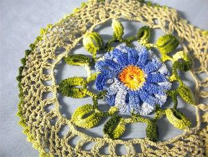 Hand Crocheted Doiley with Blue Flower. (Image1)