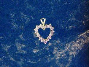 Sterling Silver And Purple Ice Heart Pendant.
