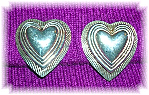 Silver  Raised Hearts Clip Earrings (Image1)