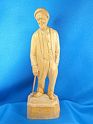 Wood Carving Old man with walking stick, by  Caron (Image1)