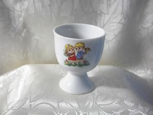 Unmarked Boy & Girl Porcelain Egg Cup