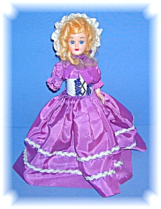 VINTAGE PLASTIC SLEEP EYE DOLL WITH SHOES (Image1)