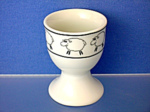 White pocelaine egg cup with fluffy Sheep. . . (Image1)