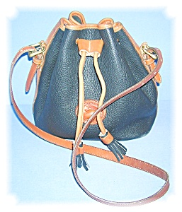 BLACK AND TAN LEATHER DOONEY AND BOURKE BAG.. (Image1)