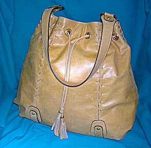 Fossil Light Tan Leather Drawstring Tote Bag. (Image1)