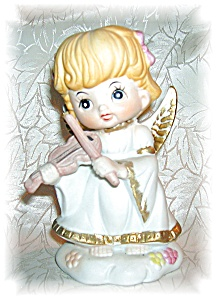 PORCELAIN ANGEL FIGURINE PLAYING A VIOLIN.... (Image1)