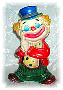 BANK - VINTAGE CLOWN BANK STANDS 7 1/2 INCHES TALL . . (Image1)