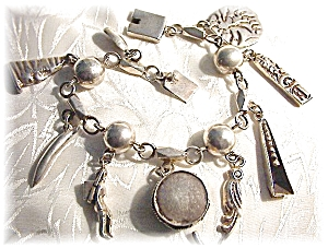 Bracelet Sterling Silver Mexican 9 Charm YM (Image1)