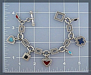 Silver 7 Charm Heart Bracelet Toggle Clasp  Marked P.D (Image1)