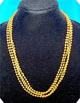TWO STRAND AMBER COLOR PLASTIC BEAD NECKLACE .  . . .