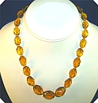 ANTIQUE FACETED AMBER GLASS BEADS  17 INCHES