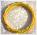 Click here to enlarge image and see more about item 0112200339: Lucite Plastic Yellow Carved  Bangle Bracelet