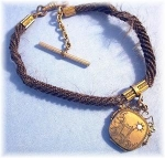 Click here to enlarge image and see more about item 0112200356: Victorian  Hair Locket Opal Ruby Watch Fob Gold Fill