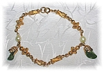 Click here to enlarge image and see more about item 0114200638: 7 3.4 Inch Goldtone Pearl Jadeite Bracelet