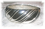 Click here to enlarge image and see more about item 0114200641: Ornate Silvertone Hinged Bangle Bracelet