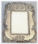 Click here to enlarge image and see more about item 0116200550: Very Decorative Silver/Wood Picture Frame