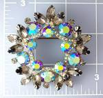 Click here to enlarge image and see more about item 0126200931: Silver Pink Grey Blue Crystal Claw Set Brooch