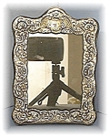Click here to enlarge image and see more about item 0223200401: Ornate Silver Photograph Frame.