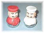 Click here to enlarge image and see more about item 0317200557: Red & White Salt & Pepper Shakers
