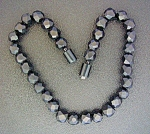 Click to view larger image of Bakelite Black Faceted 16 Inch Vintage  Necklace (Image1)
