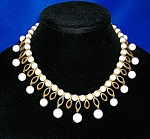 Click to view larger image of KRAMER White Lucite and Golden Teardrop Necklace (Image1)