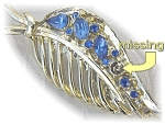 Click here to enlarge image and see more about item 0406200509: Silvertone pin with blue stones