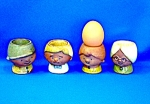 Click to view larger image of SET OF FOUR POTTERY EGG CUPS Mom Dad and 2 Kids (Image1)
