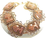 Click here to enlarge image and see more about item 0413200328: Vintage Copper & Goldstone Bracelet